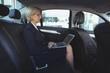 Businesswoman using laptop in car
