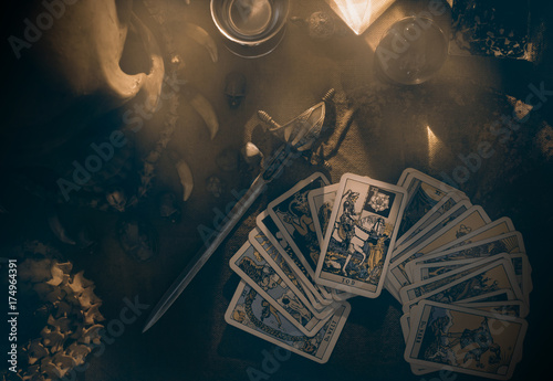 Tarot card / View of tarot card on the table under candlelight. Dark tone.