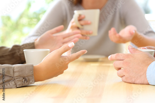 Three friends hands talking in a bar