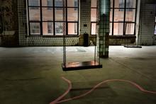 Swings In An Abandoned Old Glo...