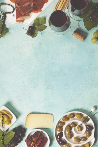 Wine and snack set on blue background