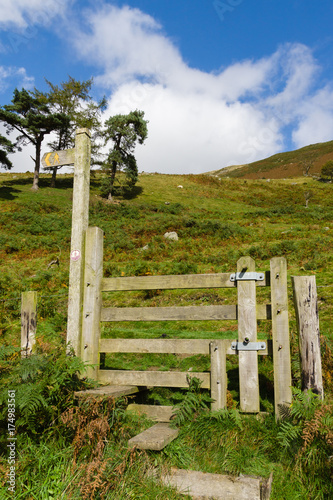 Fotografie, Obraz  Trail Sign post and stile on a rural trail in the United Kingdom