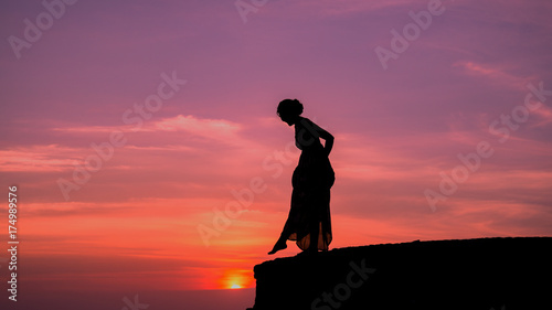 Fotobehang Jacht silhouette of woman on cliff,braves confident concept.