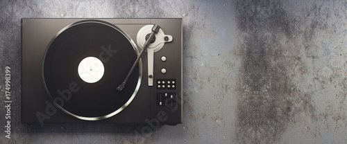 Fotografía  Vinyl record player on concrete background