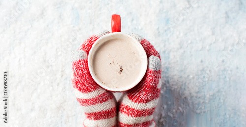 Spoed Foto op Canvas Chocolade female hands in gloves holding hot chocolate