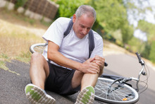 Cyclist Fell Down From Bike With Injured Knee Joint