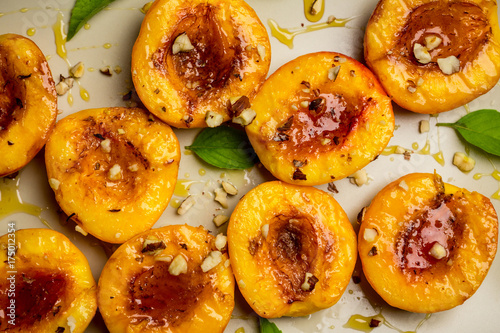 Grilled peaches on the rustic background. Shallow depth of field. Selective focus.