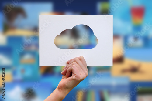 Fotografia, Obraz  Female hand holding cloud perforated paper craft