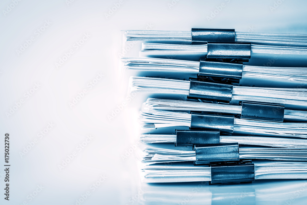 Fototapeta extreamly close up  the stacking of office working document with paper clip folder