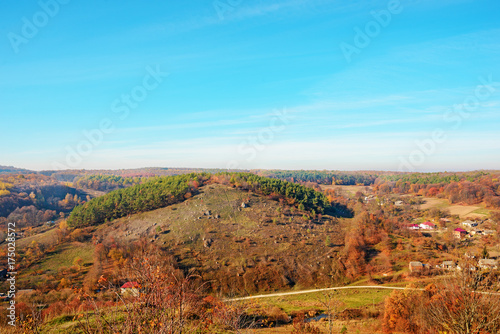 Foto op Aluminium Blauw View on the beautiful colorful autumn landscape of the hills with trees and greenfields in the countryside