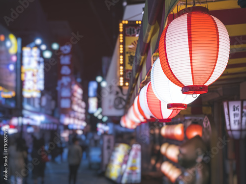 Lanterns light Japan nightlife Bar street district with blur people