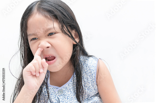 little cute girl pick her nose health care buy this stock photo