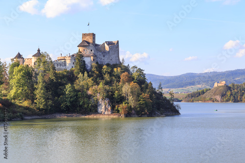 Fototapeta Lake Czorsztyn ,a man-made reservoir on Dunajec river, southern Poland, between  Pieniny and Gorce Mountains. On left is castle in Niedzica and on right castle ruins in Czorsztyn obraz na płótnie