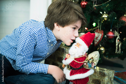 A Wish For Christmas.A Boy Is Telling His Wishes For Christmas Gifts To Santa