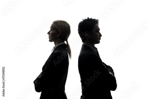 Silhouettes of caucasian businesswoman and asian businessman standing back to back Wallpaper Mural