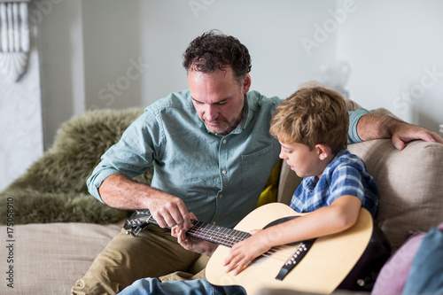 Father teaching son guitar chords - Buy this stock photo and explore ...