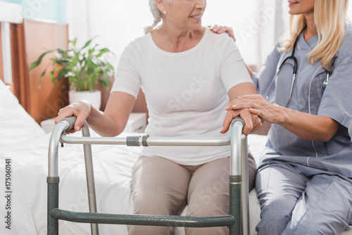 Fototapeta nurse and senior patient with walker obraz