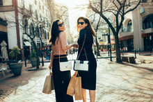 Female Shoppers Carrying Shopp...