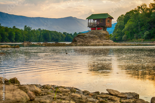 Lonely house on the river Drina in Bajina Basta, Serbia Wallpaper Mural