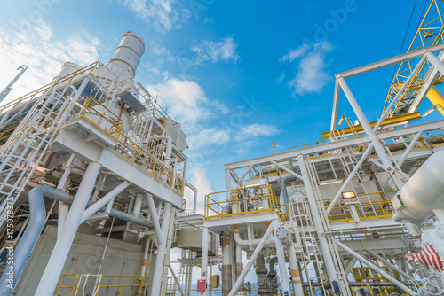 Fototapety, obrazy: Offshore oil and gas industry, gas compression systems and waste heat recovery unit of gas turbine engine exhaust stack and liquid knock out vessel.