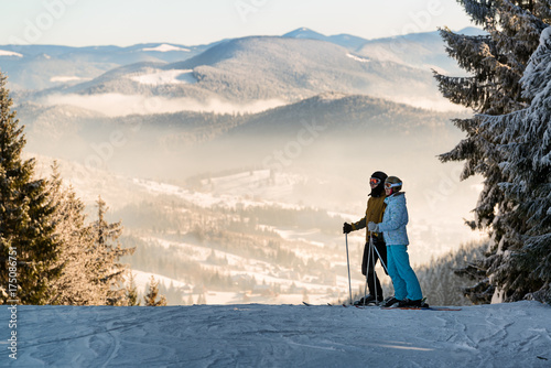 Couple of skiers in the mountains