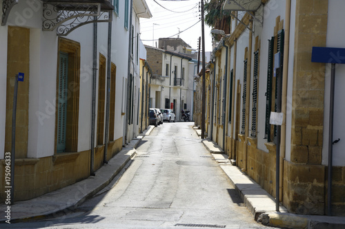 Fototapety, obrazy: Narrow street with houses in the old town
