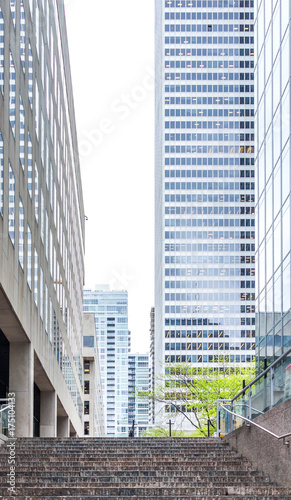 Downtown cityscape skyscraper highrise buildings with stairs or steps in city in Canvas Print
