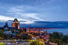 Cityscape Or Skyline Of Chateau Frontenac, Park And Old Town Streets During Sunset With Illuminated Castle, Espace 400e Building