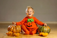 Small Boy In Pumpkin Costume P...
