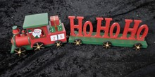Christmas Wooden HoHo Santa Claus Train Gift Decorated With Stars And A Tree