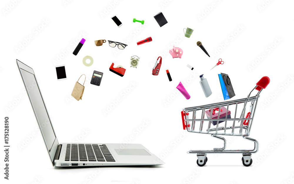 Fototapeta Shopping cart and laptop computer with products isolated on white background, shop online concept.