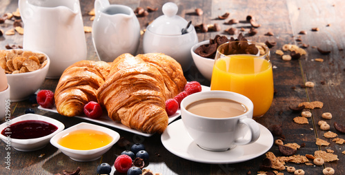 Fotografie, Obraz  Breakfast served with coffee, juice, croissants and fruits