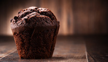 Chocolate Muffin On Wooden Table