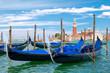 Traditional gondolas docked at St Mark's Square in Venice