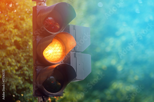 Fotografie, Obraz  Yellow light of traffic lights in summer city