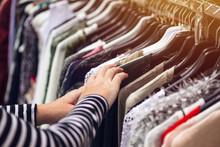 Woman Browsing Through Clothin...