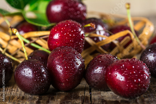 Poster Vruchten Cherry on a wooden table in a wicker