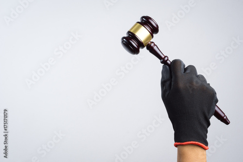 Fototapety, obrazy: Hand holding wooden judge's gavel as a illegal or injustice sign