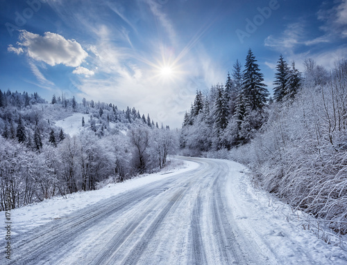 Plakat Road in the mountains covered with snow