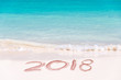 2018 written on the sand of a beach, travel 2018 new year concept
