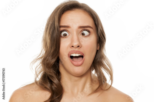 Portrait of beautiful young woman making funny faces on white background Canvas Print