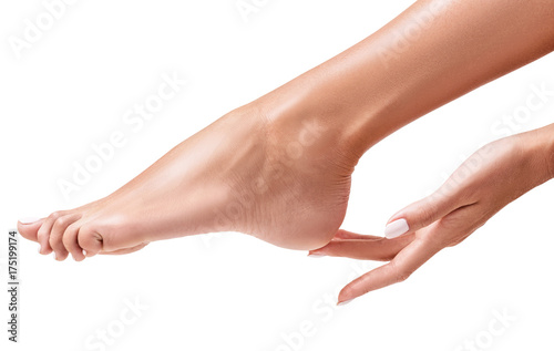 Fotobehang Pedicure Perfect female feet. Hand touches elegant leg.