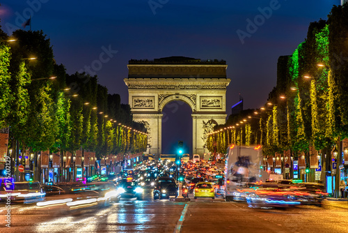 Fotobehang Parijs Champs-Elysees and Arc de Triomphe at night in Paris, France