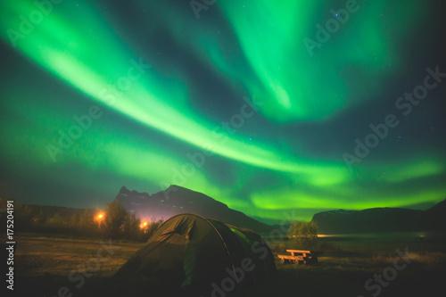 Photo  Beautiful picture of massive multicolored green vibrant Aurora Borealis, Aurora
