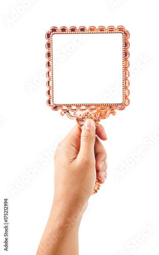Fotomural Beautiful vintage mirror for makeup in woman hand.