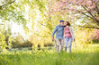 canvas print picture - Beautiful senior couple in love outside in spring nature.