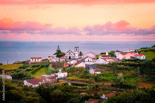 Fotografie, Obraz  Beautiful pink stunning sunrise in a village in Nordeste, Sao Miguel Island, Azo