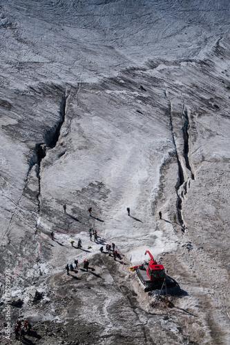 Walkers secured with ropes preparing to cross alpine glacier in summer Tapéta, Fotótapéta