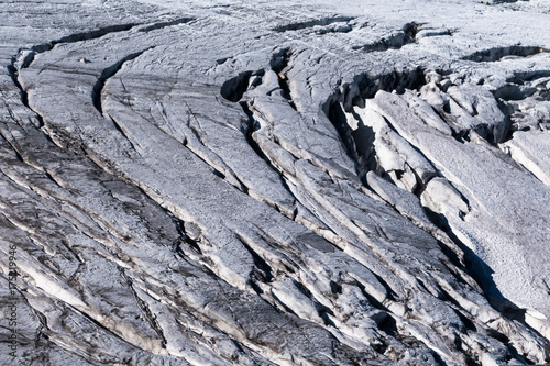 Vászonkép Alpine glacier crevasses exposed on surface in summer