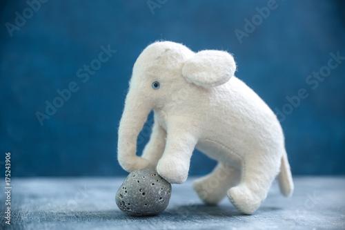 Photo  Handmade toy white elephant with gray stone